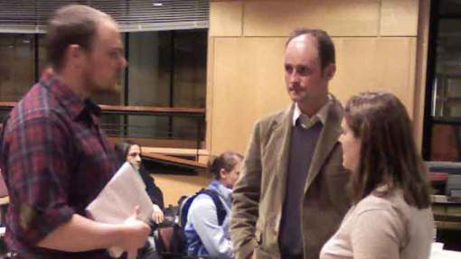 MIt student (left) chats with journalists Jonathan Fildes and Karen Weintraub.