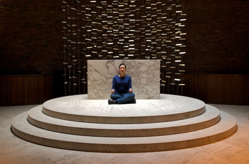 A woman sits in the Eero Saarinen chapel on campus. Photo: j9lyn, Flickr