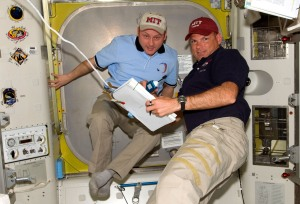 Michael Fincke '89 (left), Expedition 18 commander; and Tony Antonelli '89, STS-119 pilot, look over procedures checklists in the Quest Airlock of the International Space Station while Space Shuttle Discovery remains docked with the station. Photo: NASA