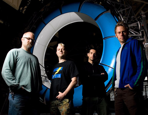 Prototype This! hosts (from left) Terry Sandin, Zoz Brooks PhD '07, Joe Grand, and Mike North, with the backyard waterslide simulator they created using the laws of physics and a whole lot of steel. The simulator makes ten 360-degree turns during a ride lasting three minutes, more than 10 times as long as a traditional water slide. Watch video of the slide in action or check out more videos from the show. Photo: Discovery Channel/Don Feria.