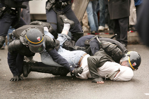 A protester is arrested by the police March 28, 2006, in Paris. Students and unions in France stepped up protests against the First Employment Contract (CPE) law, an open-ended contract for those under 26 years of age that can be terminated within the first two years without explanation from employers. (© Owen Franken)