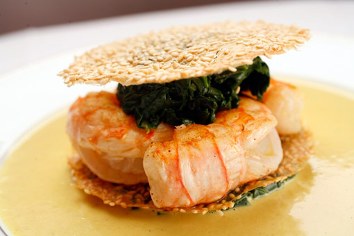 Feuillantine de queues de langoustines aux graines de sésame, sauce curry, created by Chef Bernard Pacaud at L'Ambroisie, a Michelin three-star restaurant, Place des Vosges, Paris. (© Owen Franken)
