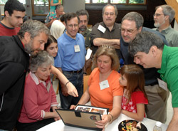 Baker House alumni reminisce over old photos.