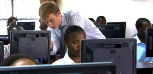 AITI teacher and MIT undergrad, Cory Smith, assists students at Strathmore University in Kenya