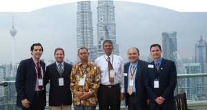 G-LAB in Malaysia : Sloan Fellows, from left, Camilo Syllos MBA '09, Alberto Gassmann MBA '09, Victor Yee MBA '09, and Marcelo Kuhn SM '09 in Kuala Lumpur, Malaysia, with two members of their client team.