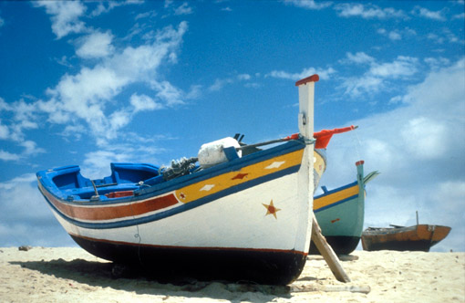 Colorful boats on the beach in Algarve, Portugal. (© Owen Franken).