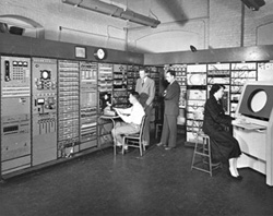 Stephen Dodd, Jay Forrester, Robert Everett, and Ramona Ferenz at Whirlwind I test control in 1950.