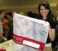 Every year the Alumni Association hands out laundry bags to new students at the Activities Midway.