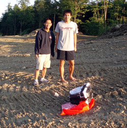 Justin Lee and Oliver Yeh retrieve the downed camera, located using the attached GPS device.