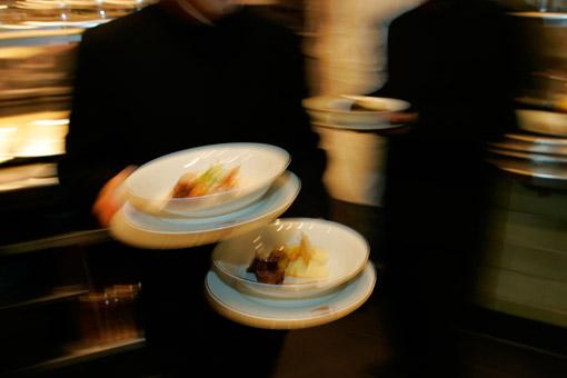 Waiters leaving the kitchen of Daniel Boulud's great French restaurant in New York, Daniel (© Owen Franken).