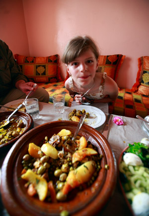 Enjoying a meal in the Atlas Mountains of Morocco (© Owen Franken).
