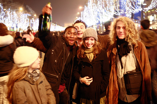 New Year's Eve 2007 on the Champs Elysee. Franken's son, Tunui (far right), his girlfriend, Cecile (to his left), and his daughter (far left), Manui (© Owen Franken).