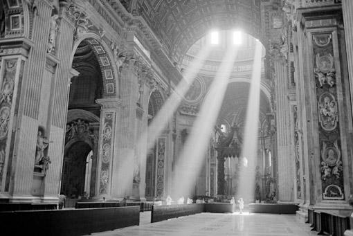 Sunbeams inside St. Peter's Basilica, Vatican City (© Owen Franken).