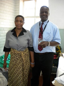 Dr. Nyengo Mkandawire, the only Malawian-born orthopedic surgeon operating in Malawi today, with a patient of his who had been treated for four months by a traditional healer for a herniated disc in her low back. She was unable to walk when she came to Queens Hospital. Mkandawire performed a lumbar discectomy surgery on her, and just before this picture was taken, they were dancing together!