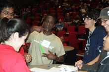Contestants work a physics problem at the 2008 challenge