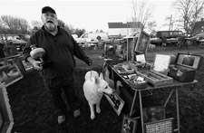 Photograph of Mike Jones, a vendor, showing up at the lot with his big white dog named Leah.